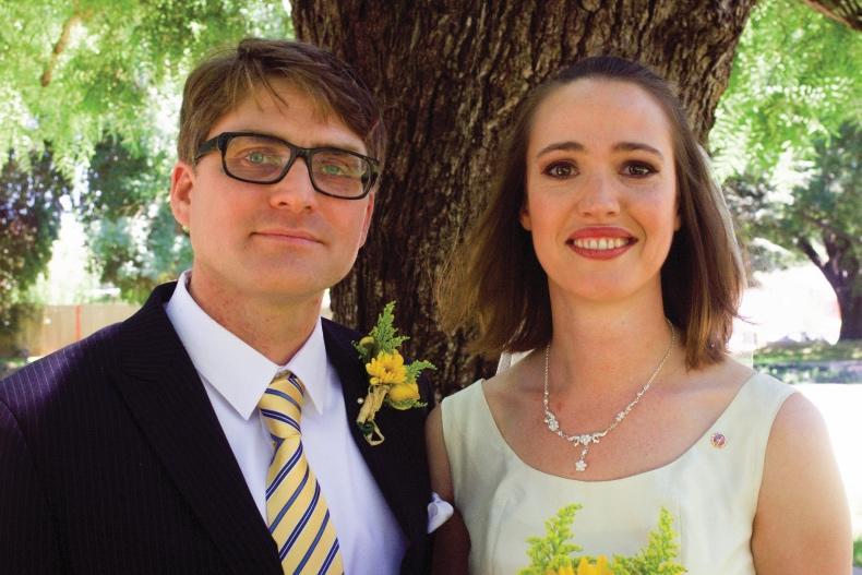 Army veteran and facilitator Katy with husband at their wedding